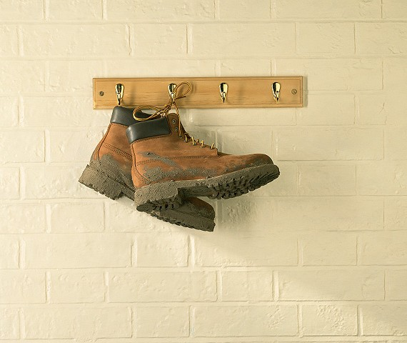 hiking boots on wall