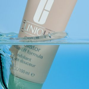 Water splash cosmetic product photography