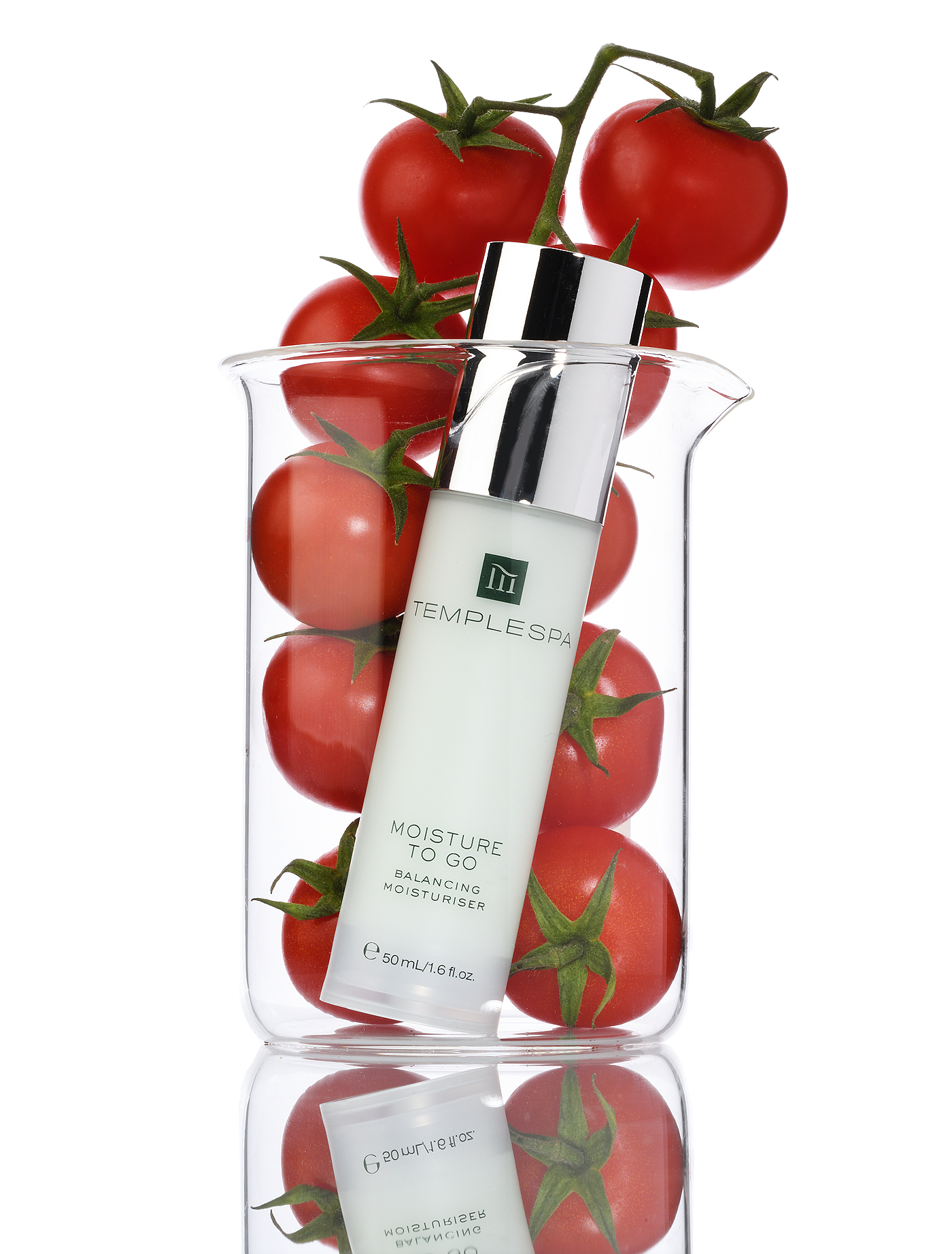 Tomatoes in a beaker with white background